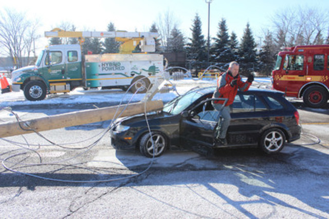 Toronto Fire Services demonstrates how to exit a car safely if powerlines come down and there's a fire. (CNW Group/Toronto Hydro Corporation)
