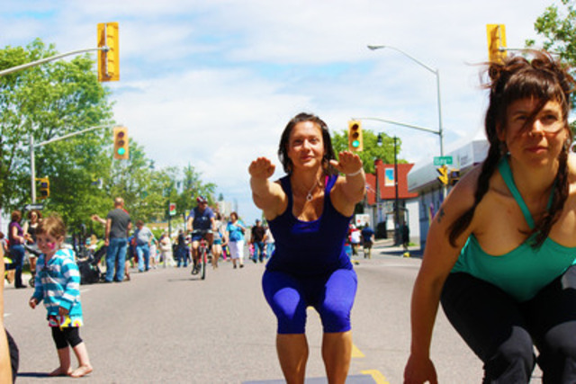 Participant practices yoga on the street at Open Streets in Thunder Bay (CNW Group/Open Streets Toronto)