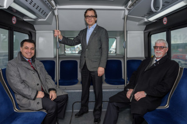 Left to right: David De Cotis, President of the STL's Board of Directors and Vice President of the City of Laval Executive Committee; Guy Picard, Director General of the STL; Gilbert Dumas, Vice President of the STL's Board of Directors and Municipal Councillor Marc-Aurèle-Fortin onboard one the the STL's hybrid buses. (CNW Group/Société de transport de Laval)