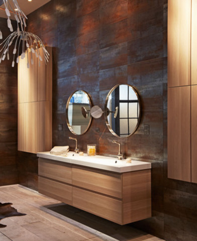 IKEA moves away from showing cold spa bathroom and creates a whimsical dream space with beautiful light oak GODMORGON bathroom cabinetry mixed with a copper antique tub, oversized fire place and stunning tile. Photo credit: Michael Graydon Photography (CNW Group/IKEA Canada)