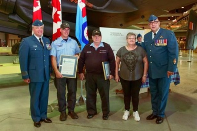 Left to right: Colonel Colin Keiver, Base Commander, Canadian Forces Base Trenton, Commissionaire Alan McDonald, Commissionaire Art Burke, Mrs. Burke, Chief Warrant Officer Darcy Elder. (CNW Group/Commissionaires)