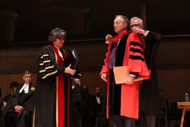 The Hon. George W. Adams, QC (centre) was conferred with the degree of Doctor of Laws honoris causa by Law Society Treasurer Janet E. Minor (left) at the Jan. 29th Call to the Bar ceremony at Roy Thomson Hall in Toronto. Law Society Bencher Peter Wardle (pictured) places the ceremonial LLD hood on Mr. Adams. (CNW Group/The Law Society of Upper Canada)