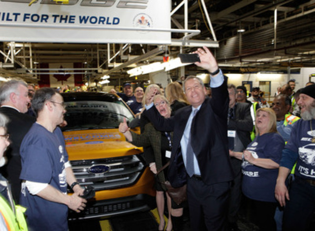 Joe Hinrichs, Ford's president of the Americas, joins Oakville Assembly employees to celebrate the official start of production of the all-new 2015 Ford Edge.  In total, 1,400 employees have been hired since 2014 to support the new global vehicle. (CNW Group/Ford of Canada)