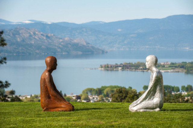 """Twin sculptures, one in corten steel - the other aluminum, sit tranquilly overlooking the spectacular Lake Okanagan. Sculpture Names: """"Flow 1 & 2"""" (CNW Group/Mission Hill Family Estate)"""