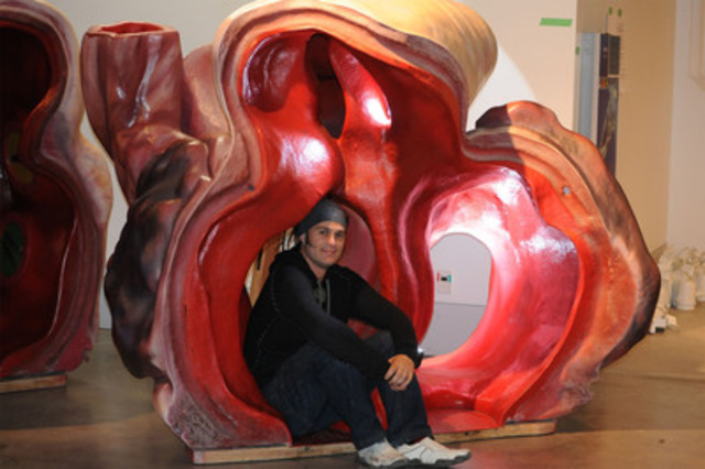 Shane James, collections manager with the Museum of New Zealand, fits inside an artery of a life-sized model of a blue whale's heart. Featured in Whales Tohora, a visiting exhibit opening March 2 at the Canadian Museum of Nature, the blue whale's heart can tip the scales at 640 kg. (CNW Group/Canadian Museum of Nature)