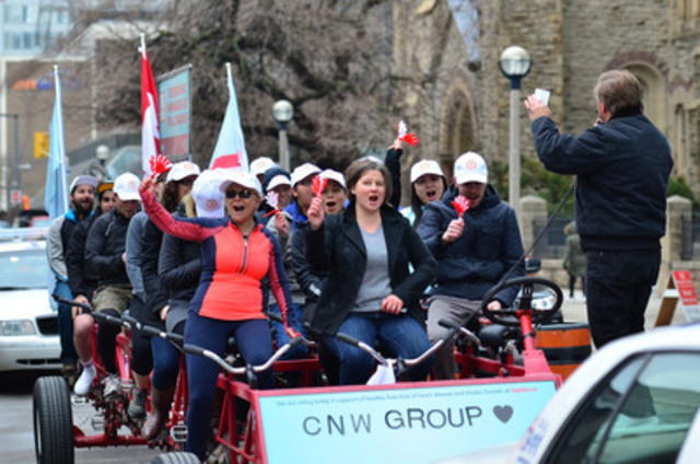 And they're off! Team CNW Group rides the Big Bike in support of the Heart and Stroke Foundation (CNW Group/CNW Group Ltd.)
