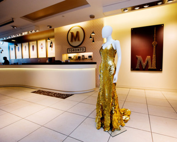 Fashion designer Zac Posen's 24-karat gold dress valued at $1.5 million is displayed at the first ever North American Magnum Pleasure Store in Toronto on July 17th, 2013. (Michelle Siu for CNW) (CNW Group/Magnum)