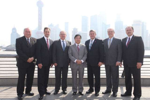 With the Shanghai skyline behind them, Premiers McLeod, Ghiz, Dexter, Alward, Selinger and Pasloski, stand with Philip Lee, Lieutenant Governor of Manitoba (CNW Group/Council of the Federation)