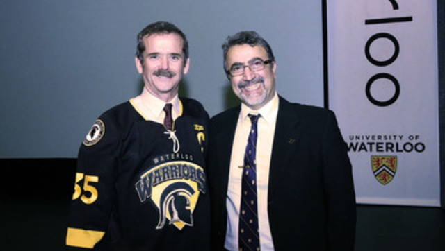 Canadian astronaut, Chris Hadfield, gave his first public lecture at the University of Waterloo since being appointed a professor of aviation earlier this year. He is pictured with Waterloo's president and vice-chancellor, Feridun Hamdullahpur. (CNW Group/University of Waterloo)