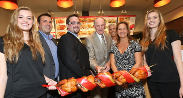 From left to right: Mackenzie Verner, cashier; Richard Scofield, Vice-President, Operations; Reg Wynes, General Manager; William Bishop, Mayor of Rothesay; Jessé Campeau, Assistant director, Customer experience and openings; Elisabeth David, Supervisor, Operations; Madison Verner, cashier. (CNW Group/Les Rôtisseries St-Hubert)