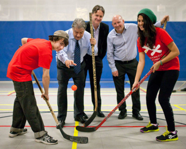 To celebrate a $100,000 grant from The Coca-Cola Foundation, Mayor of London, Hon. Joe Fontana, left, is joined by Chris Harvey, CEO, Boys and Girls Club of London, middle, and Blair Ellery, District Sales Manager, Coca-Cola Refreshments Canada, as the ball drops on a fun game of floor hockey to kick off a new active healthy living program in London. (CNW Group/Boys and Girls Clubs of Canada)