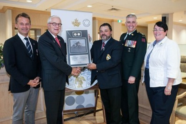 From left: Seamus O'Regan, MP (St. John's South – Mount Pearl), Carman Joynt, Chair, Royal Canadian Mint Board of Directors, Frank Gogos, Chair of the Royal Newfoundland Regiment Museum, Major Michael Bennett, 1st Battalion, Royal Newfoundland Regiment, and Cathy Bennett, Minister of Finance and President of the Treasury Board, Government of Newfoundland and Labrador at the Mint's presentation of the 100th Anniversary of the Battle of Beaumont-Hamel silver collector coin to the Royal Newfoundland Regiment. (CNW Group/Royal Canadian Mint)