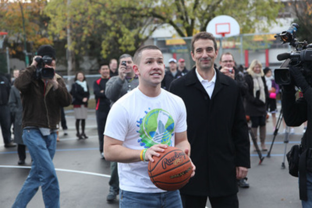Dan Jeffries, Coca-Cola Canada (right) asks James Naknakin, member of the youth advisory team for a new sport court in Vancouver's inner-city, to take the first shot at the basket on opening day. The court is the result of a $350,000 investment made by Coca-Cola Canada during the Vancouver 2010 Olympic and Paralympic Winter Games. (CNW Group/Coca-Cola Canada)