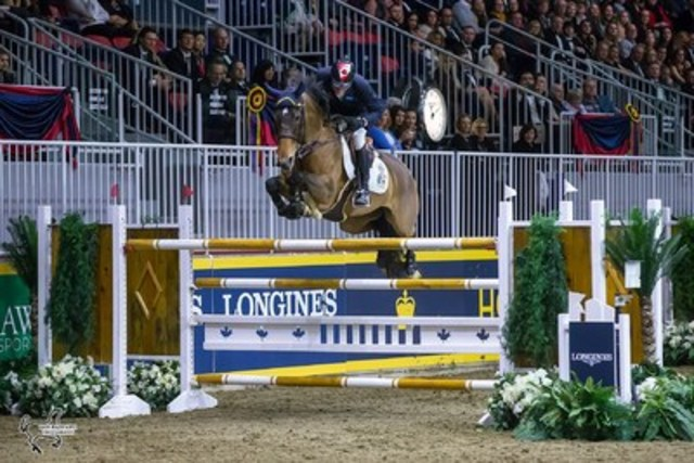 Ten-time Olympian Ian Millar of Perth, ON, placed third in the $75,000 GroupBy 'Big Ben' Challenge, named for his legendary mount.  Millar was presented with the Lt. Col. Stuart C. Bate Memorial Trophy as the Leading Canadian Rider at the CSI4*-W Royal Horse Show in Toronto, ON. Photo by Ben Radvanyi Photography (CNW Group/Royal Agricultural Winter Fair)