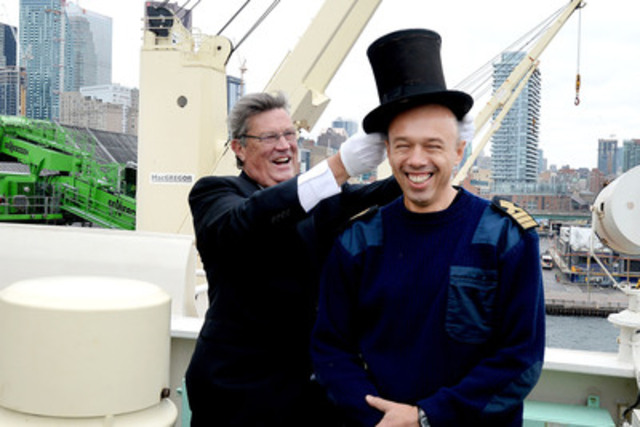 "PortsToronto Harbour Master Angus Armstrong ""crowns"" M/V Tundra Captain Tykhonov Vyacheslav with the centuries-old silk and beaver top hat at the 154th annual Beaver Hat Ceremony at Redpath Refinery. (CNW Group/PortsToronto)"