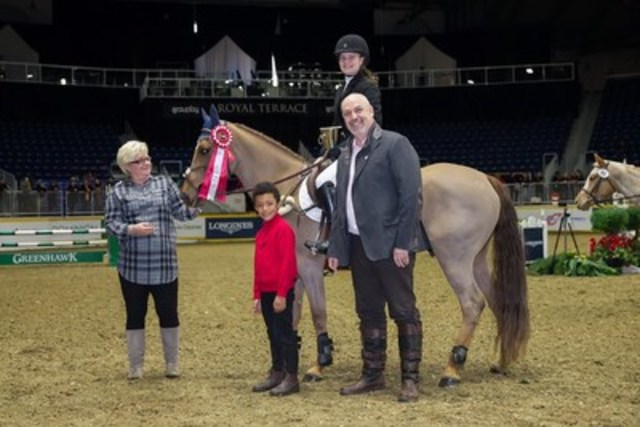 Laura Robertson of Toronto,ON, is joined by presenting sponsors Marion Cunningham and William Tilford of Marbill Hill Farm after winning the $5,000 Royal Pony Jumper Final on the final day of the Royal Horse Show®. (CNW Group/Royal Agricultural Winter Fair)