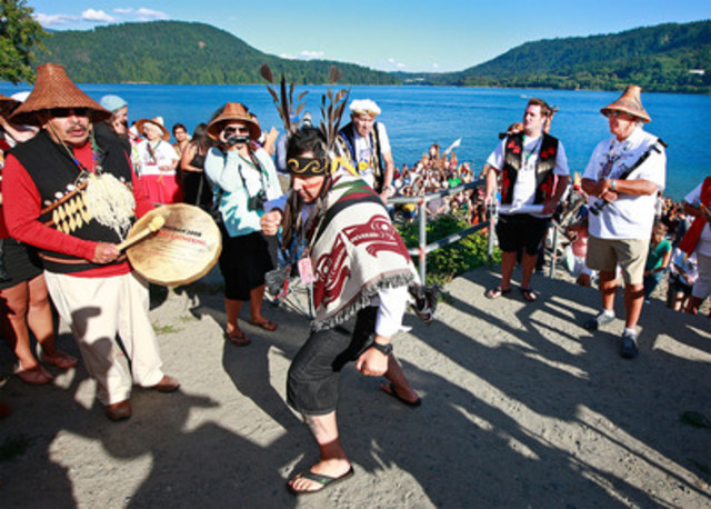 Chief Bill Williams of Squamish Nation, Chief Justin George of Tsleil-Waututh Nation, and Chief Gibby Jacob of Squamish Nation, welcome paddlers to Whey-Ah-Wichen, as Gabriel George of Tsleil-Waututh Nation dances. (CNW Group/Tsleil-Waututh Nation)