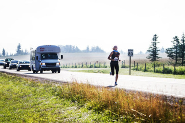 Participants run through the foothills of the Rockies during the 100 km team relay marathon. (CNW Group/Sears ...