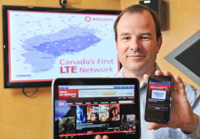 John Boynton, Executive Vice President and Chief Marketing Officer, Rogers Communications Inc., displays two of Rogers first LTE wireless devices: HTC JetstreamTM LTE tablet and Samsung Galaxy S II TM LTE smartphone. Rogers officially launched its LTE wireless network today in Toronto, Montreal and Vancouver. (CNW Group/Rogers Communications Inc.)