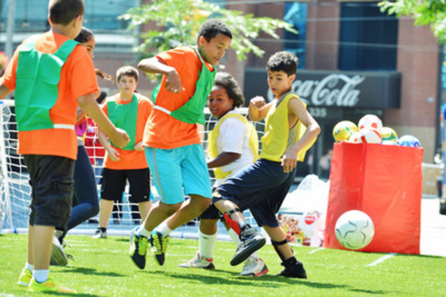 Youth from Toronto Boys and Girls Clubs join Coca-Cola Canada to celebrate soccer with a tournament together on Ontario St in downtown Toronto. (CNW Group/Boys and Girls Clubs of Canada)
