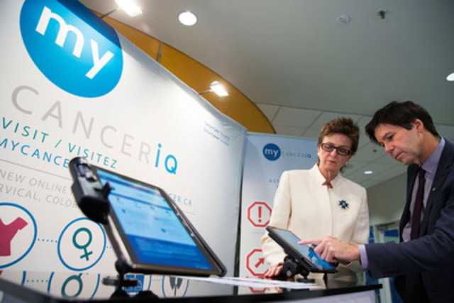 Dr. Linda Rabeneck, VP, Cancer Care Ontario, demonstrates My CancerIQ tool to Minister of Health and Long-Term Care, Dr. Eric Hoskins, at the YMCA in Toronto on Tuesday, Feb. 3, 2015. (CNW Group/Cancer Care Ontario)