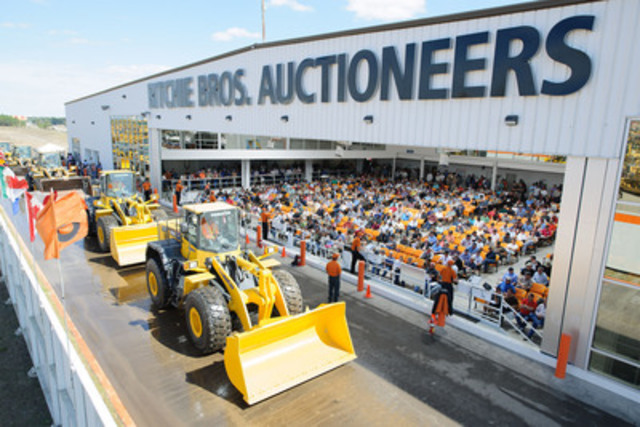 More than 375 wheel loaders, including these Komatsu units rolling across the ramp, were sold at Ritchie Bros. ...
