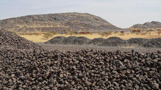 Manganese stockpiles at the Takavasita Deposit with Hill D and Hill E (right) in background (CNW ...