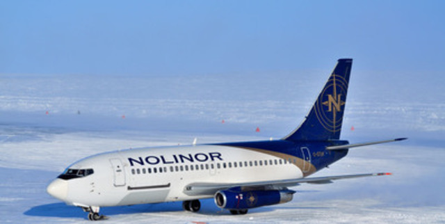 A Nolinor Aviation Boeing 737 prepares to offload it's cargo at a remote mineral exploration site after landing on an ice runway in Nunavut, Canada. (CNW Group/Uppik Aviation)
