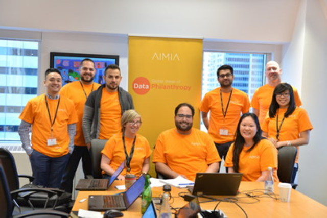 Aimia's team in Toronto comes together to analyze data and uncover insights for a non-profit (CNW Group/AIMIA)