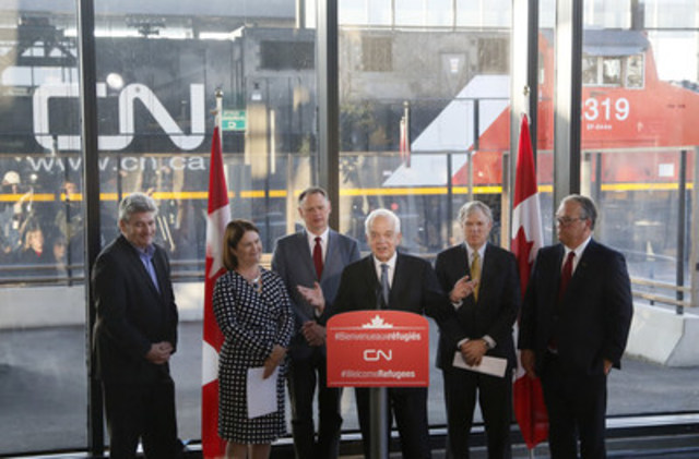 CN pledges $5 million to assist Syrian refugees resettling in Canada. (From left to right) John Fraser, MPP Ottawa-South; the Honourable Jane Philpott, Minister of Health; David McGuinty, MP for Ottawa-South; the Honourable John McCallum, Minister of Immigration, Refugees and Citizenship; Luc Jobin, executive vice-president and chief financial officer of CN; and Robert Pace, chairman of the board of directors of CN, are shown at the announcement, Friday, December 11, 2015, at the Ottawa Train station. (Photo Credit: The Canadian Press Images PHOTO/CN) (CNW Group/CN)