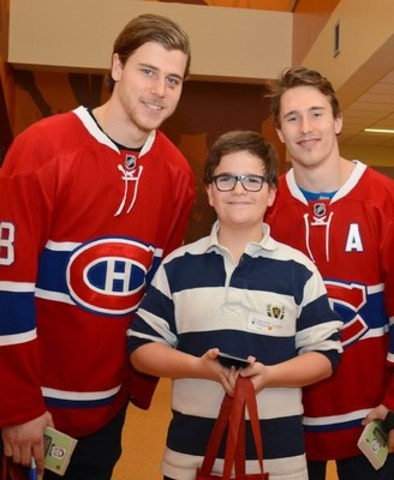 From left to right : Nate Beaulieu with a Canadian Shriners Hospital patient and Brendan Gallagher (CNW Group/Shriners Hospitals For Children)