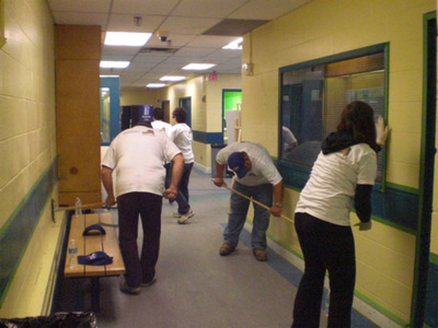 Lowe's employees and community volunteers prepare the walls of Maple Lions Arena for a much-needed coat of paint. The renovations were part of rink renovations completed through the Lowe's and Hockey Canada Community Rink Renovation program. (CNW Group/Lowe's Canada)