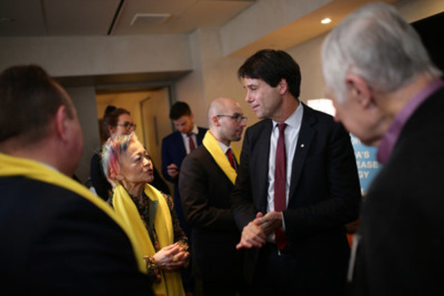 Ontario Health Minister Eric Hoskins speaking with Durhane Wong-Rieger, President and CEO of the Canadian Organization for Rare Disorders, at Queen's Park on International Rare Disease Day. (CNW Group/Canadian Organization for Rare Disorders)