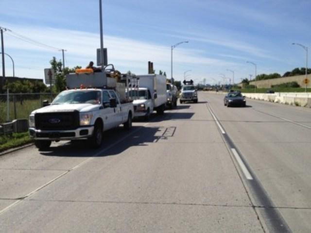 Le convoi d'Herbanatur à l'œuvre sur les autoroutes de Montréal. (Groupe CNW/Herbanatur Inc.)