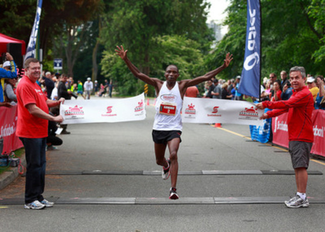 Kip Kangogo from Lethbridge, Alberta surges through the finish line Sunday, June 23 to win the 2013 Scotiabank Vancouver Half-Marathon & 5K with a time of 1:03:33. The event raised $725,000 for 71 local charities through the Scotiabank Charity Challenge. (CNW Group/Scotiabank - Sponsorships & Donations)