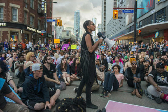 Black Lives Matter activist Janaya Khan organizes a sit-in during the Trans Pride March in Toronto on July 1, 2016. This photo was captured by Eduardo Lima as part of his Tom Hanson Photojournalism Award internship. THE CANADIAN PRESS/Eduardo Lima (CNW Group/Canadian Journalism Foundation)