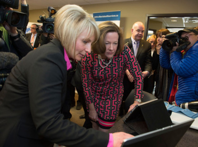 Premier Alison Redford and Christine Schelstraete, Virtual Care Nurse, MyHome Health Program participate in demonstration of the in-home technology supporting heart patients. (CNW Group/GE Healthcare)