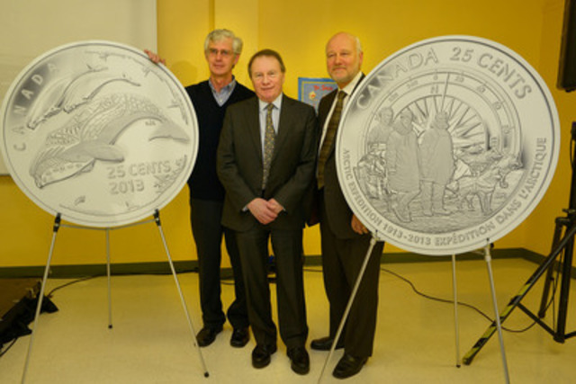 Canadian Museum of Nature Research Associate Dr. David Gray, Royal Canadian Mint President and CEO Ian E. Bennett and Member of Parliament for Nanaimo-Alberni James Lunney unveil new 25-cent circulation coins celebrating the 100th anniversary of the Canadian Arctic Expedition and Life in the North at the Greater Victoria Public Library (CNW Group/Royal Canadian Mint)