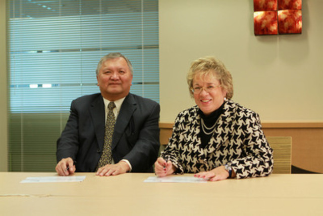 Today in Vancouver, Gitxsan Hereditary Chief Elmer Derrick signs historic equity agreement with Janet Holder, Executive Vice President of Western Access for Enbridge. (CNW Group/Gitxsan Hereditary Chiefs)