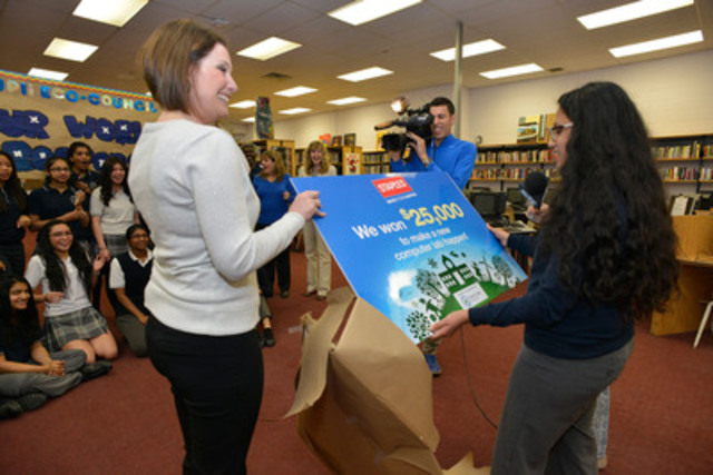 Leigh Pearson, director of environment at Staples Canada surprises Blessed Pope John Paul II Catholic Secondary School students with the news that they won $25,000 toward new technology in the Staples Canada Recycle for Education Computer Lab Contest. (CNW Group/Staples Canada Inc.)