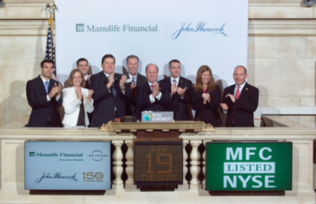 Manulife Financial President and Chief Executive Officer Donald Guloien, joined by senior management and the company's STARs of Excellence Program honourees, rings The Opening Bell(SM) at the New York Stock Exchange. (CNW Group/Manulife Financial Corporation)