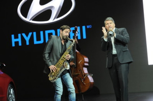 Hyundai spokesperson in Quebec, Guillaume Lemay-Thivierge, and Don Romano, President and CEO of Hyundai Auto Canada Corp. play some jazz at the Montreal Auto Show to celebrate Hyundai's sponsorship of the Festival International de Jazz de Montreal. (CNW Group/Hyundai Auto Canada Corp.)