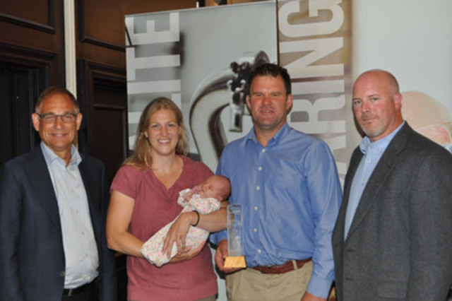 Congratulations to Clovermead Farms for winning the 2014 Dairy Farm Sustainability Award at the Dairy Farmers of Canada AGM. From left to right: Wally Smith, DFC president, Kelly and Korb Whale from Clovermead Farms, and Jason Cleveland, DeLaval Canada. (CNW Group/Dairy Farmers of Canada (DFC))