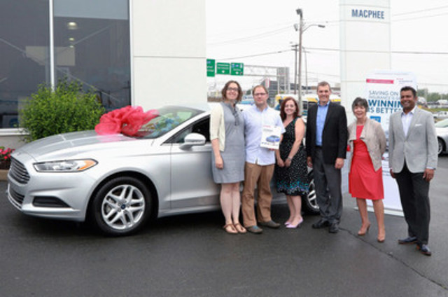 (l-r) Jennifer Parker and Chris Geroux receive their brand new 2016 Ford Fusion from Nathalie Gauthier Jacobi of MCT Insurance, David Fitzpatrick of Economical Select, Elizabeth Cosgrove and Vivek Swamy of MCT Insurance. (CNW Group/Economical Insurance)
