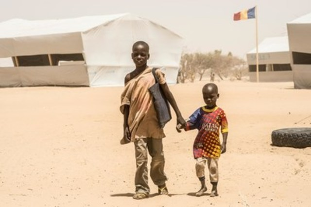 In April 2015, Bello, 12, walks home from school with his younger brother, Alei Kolo, in Chad's Dar es Salam camp. Their family is among more than 4,900 Nigerian refugees in the camp where UNICEF has set up 16 temporary learning spaces and has provided teaching materials and school supplies, as well as other educational support for children in the camp. (CNW Group/UNICEF Canada)