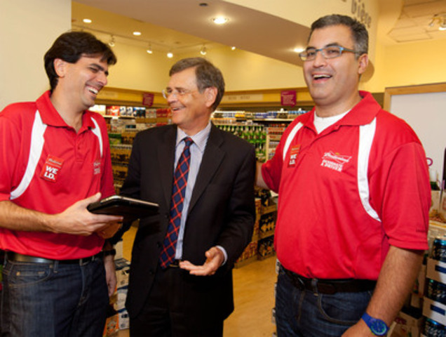 LCBO President and CEO Bob Peter (centre) takes Budweiser's pledge against drinking and driving alongside Labatt President Bary Benun (left) and Vice President Charlie Angelakos (right) during Labatt's annual Be(er) Responsible Day. Labatt employees visited LCBO outlets across Toronto and London to raise awareness of the importance of responsible use and moderation. (CNW Group/Labatt Breweries of Canada)