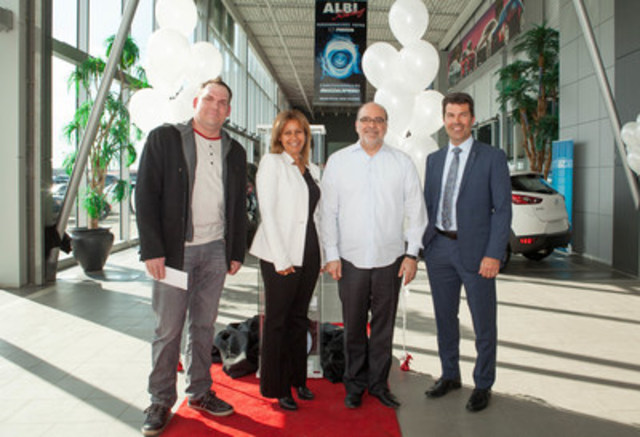 Bruno-Pierre Gougeon, owner of the 2 Millionth Mazda sold in Canada stands with Rania Guirguis, Mazda Dealer Business Manager, Quebec West, Denis Leclerc, owner of Albi Le Géant Mazda, and Jacques Parent, Mazda Regional Manager, Quebec West. (CNW Group/Mazda Canada Inc.)