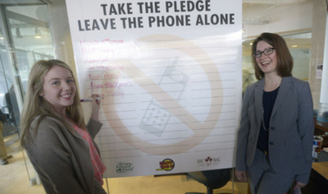 Amanda Dean, right, Vice-President, Atlantic, Insurance Bureau of Canada, with P.E.I high school student Cassie Murray who signed a pledge to not drive while distracted. THE CANADIAN PRESS IMAGES/Brian McInnis (CNW Group/Insurance Bureau of Canada)