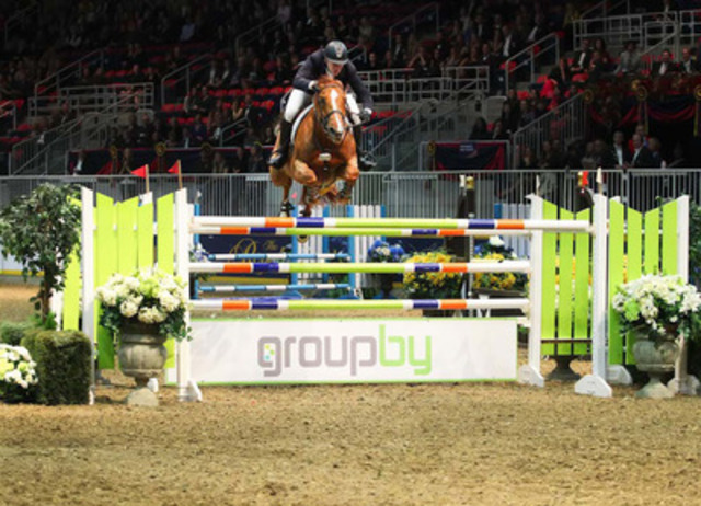 America's McLain Ward and Rothchild charge over the GroupBy oxer to take the $100,000 Hickstead FEI World Cup™ Grand Prix presented by GroupBy, Wednesday evening at the Royal Horse Show. Ward also took the afternoon's $15,000 McKee Family International Jumper Challenge with Wings. Photo credit: Ben Radvanyi (CNW Group/The Royal Agricultural Winter Fair)