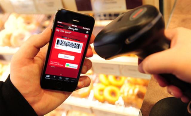 Tim Hortons annonce le lancement du paiement mobile par codes à barres dans ses restaurants au Canada et aux États-Unis, procurant un moyen sécuritaire, rapide et facile de « balayer et payer » pour les utilisateurs d'iOS, de BlackBerry et d'Android. (Groupe CNW/Tim Hortons)